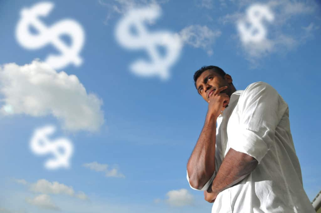 man thinking of how to make money