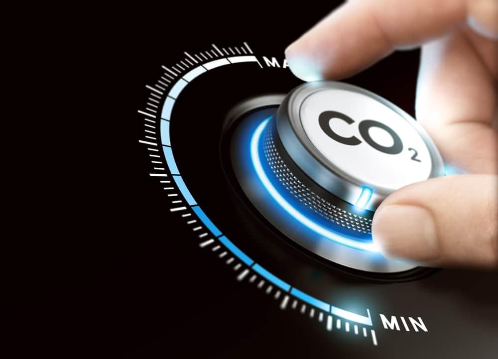 Man turning a carbon dioxide knob