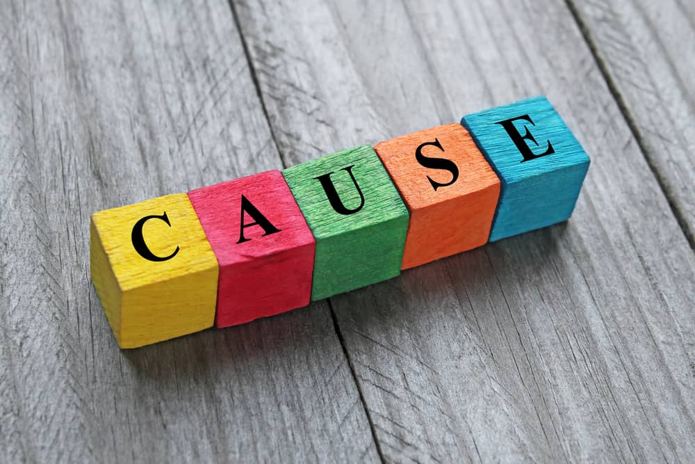 word cause on colorful wooden cubes