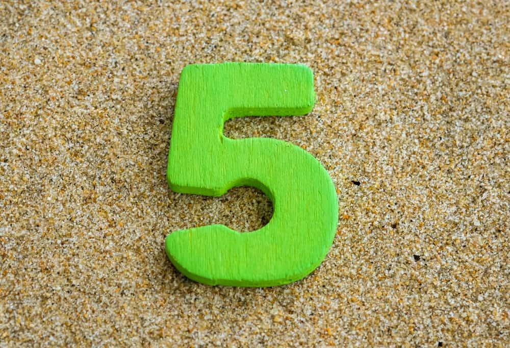 5 on sand backround