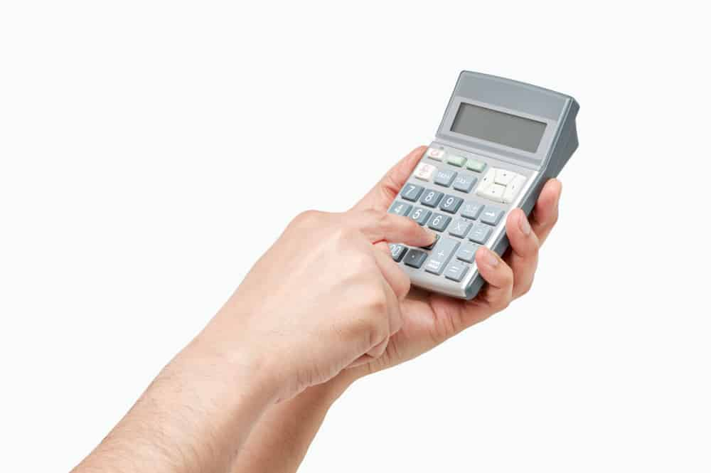 hands holding and using a calculator